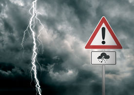 stock photo of lightning-rod  - A dark cloudy sky with a lightning bolt and a warning sign in the foreground   - JPG