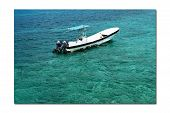image of gulf mexico  - Single anchored boat off the coast of Mexico - JPG