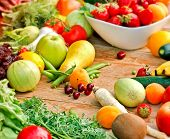 stock photo of abundance  - The abundance of fresh organic fruits and vegetables on table - JPG