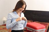 foto of undressing  - Businesswoman traveler undressing in a hotel room after a business travel - JPG