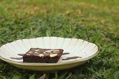 stock photo of brownie  - Chocolate Brownies cake on a white plate - JPG