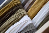 pic of chokers  - Close up of cotton scarves on a shelf - JPG