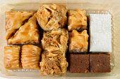 stock photo of baklava  - Variety of Turkish baklava in a plastic box - JPG