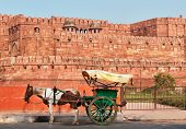 foto of carriage horse  - Indian carriage with horse is waiting of passengers at the entrance to Agra Fort - JPG