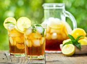 picture of iced-tea  - Iced tea with lemon and mint in the gass on the table - JPG
