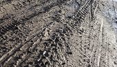 stock photo of boggy  - Wheel tracks on the dirt road after the rain - JPG
