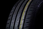 image of asymmetric  - wet tire with asymmetric tread close - JPG