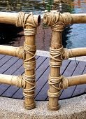 stock photo of sloop  - Bamboo fence was built as a rope tied to a bamboo fence - JPG