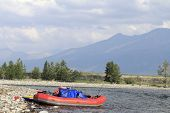 stock photo of raft  - Rafting on a Siberian river Oka among the mountains of Tien Shan - JPG