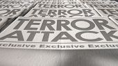 stock photo of generic  - A long row of folded newspapers at the end of a press run with a generic headline that reads terror attack on the front page on an isolated white background - JPG
