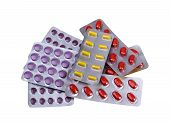stock photo of blisters  - Medicine pills and capsules packed in blisters isolated on white background - JPG
