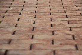 stock photo of toga  - sidewalk tiles in brown togas leaving forward - JPG