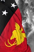 picture of papua new guinea  - Papua New Guinea waving flag on a bad day - JPG