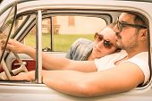Couple In Love Having A Rest During Honeymoon Vintage Car Trip - Hipster Lifestyle Traveling Around poster
