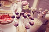 picture of cake pop  - Capture of Delicious cake pops on table - JPG