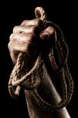 pic of gallows  - Male hand with rope on black background - JPG