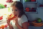 image of refrigerator  - woman eats sweets at night to sneak in a refrigerator - JPG