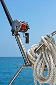 stock photo of rod  - Fishing rod and reel on a sailing yacht - JPG