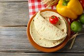 image of whole-wheat  - Stack of homemade whole wheat flour tortilla and vegetables on plate - JPG
