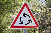 foto of traffic sign  - Roundabout triangle traffic sign on nature background - JPG
