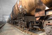 stock photo of train track  - Train with oil railway cisterns on the track - JPG
