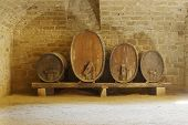 stock photo of basement  - four cider or wine barells in a basement - JPG