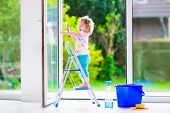 picture of cleaning house  - Little girl washing a window - JPG