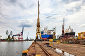picture of shipyard  - Ships and cranes in shipyard of Gdansk Poland - JPG