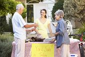 stock photo of yard sale  - Teenage Girl Holding Yard Sale - JPG