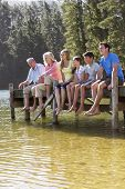 image of jetties  - Three Generation Family Sitting On Wooden Jetty Looking Out Over Lake - JPG