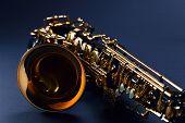 picture of saxophones  - closeup of black saxophone focus on center  - JPG