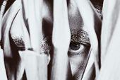 pic of peep  - Eye of peeping young man close up - JPG