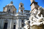 stock photo of piazza  - Saint Agnese in Agone with Egypts obelisk in Piazza Navona Rome Italy - JPG