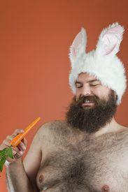 pic of sarcastic  - Sarcastic bearded fat man wears silly bunny ears - JPG