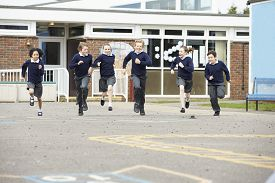 picture of playground school  - Group Of Elementary School Pupils Running In Playground - JPG