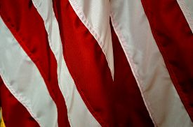 foto of emblem  - Red stripe patriotic holiday background of the american flag closeup - JPG
