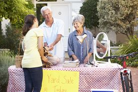 stock photo of yard sale  - Senior Couple Holding Yard Sale - JPG