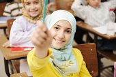stock photo of students classroom  - Adorable Muslim girl in classroom with her friends children students - JPG