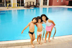 foto of swimming pool family  - On the pool together - JPG
