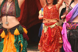 stock photo of belly-dance  - Belly Dancers Performing at a Festival Close - JPG