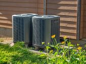 Air Conditioning And Heating Units Outside Of A Home poster
