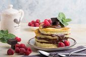 Pancakes. Stack Of Pancakes Topped With Chocolate  And Raspberry. Breakfast. Sweet Pancakes. Stack O poster