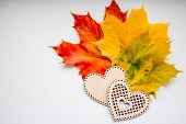 Still Life Of Wooden Hearts And Colorful Leaves.autumn Still Life, Copy Space, Dark Background, Autu poster
