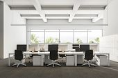 Company Office Interior With A Gray Carpet And Rows Of White Computer Desks. Industrial Style Interi poster