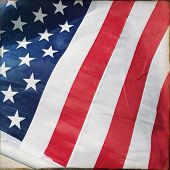 Filtered image of an American flag waving in a suburban neighborhood - USA flag for 4th of July Inde poster