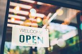 A Business Sign That Says 'open' On Cafe Or Restaurant Hang On Door At Entrance. Vintage Color Tone poster