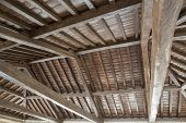 stock photo of tithe  - Modern wooden roof with main beam and joist - JPG