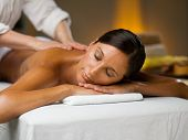 stock photo of low-necked  - Young woman on a massage - JPG
