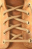 stock photo of grommets  - close up of a brown leather boot and laces - JPG