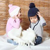 foto of knitwear  - Little kids dressed in warm knitwear for cold weather - JPG